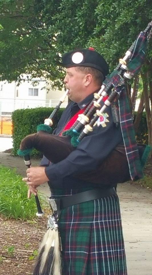 bagpipers in Scottish tartan uniform, in marching band ... |Police Pipe Band Uniforms
